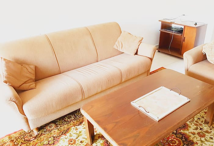 Common room+sofa for single tourist at Bat Yam