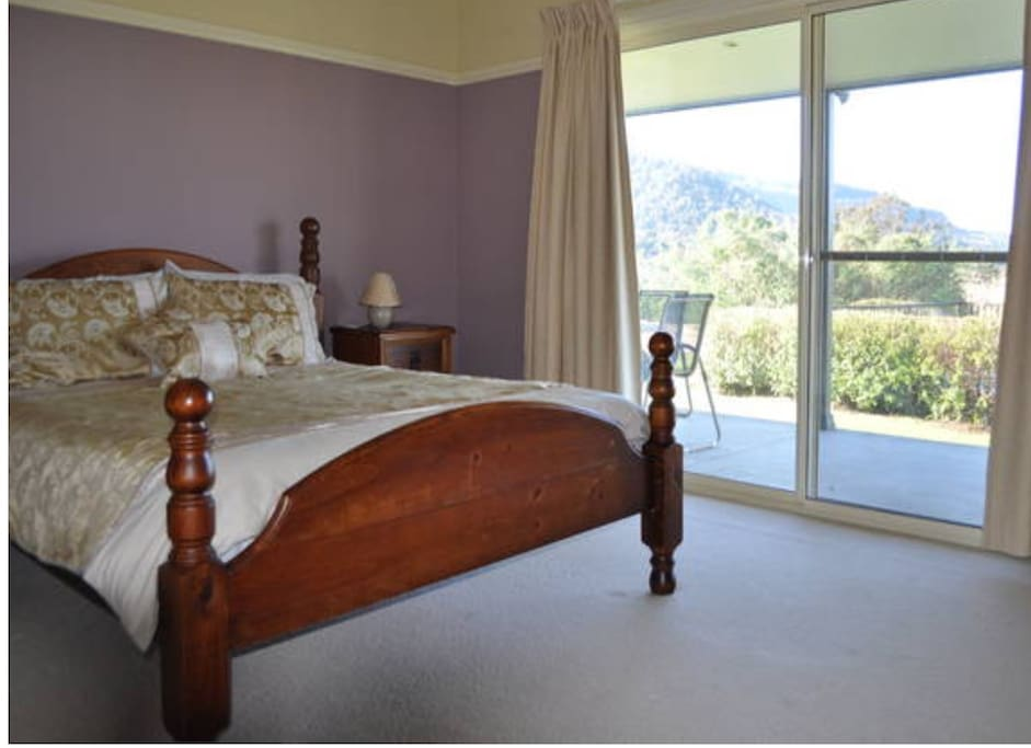 View from the main bedroom, queen bed, ensuite and walk in robe