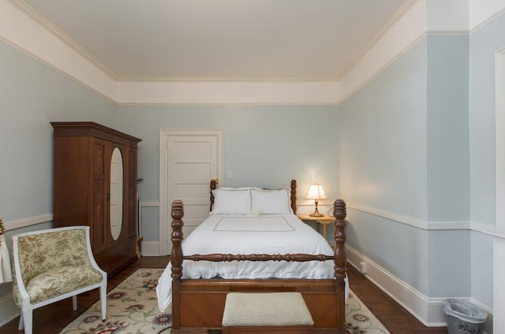 One of the bedrooms at Bennett with a full size bed.