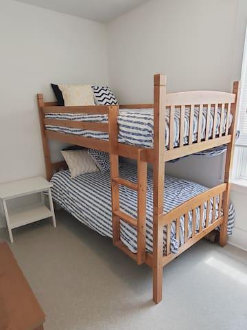 Main floor bedroom with bunk beds.