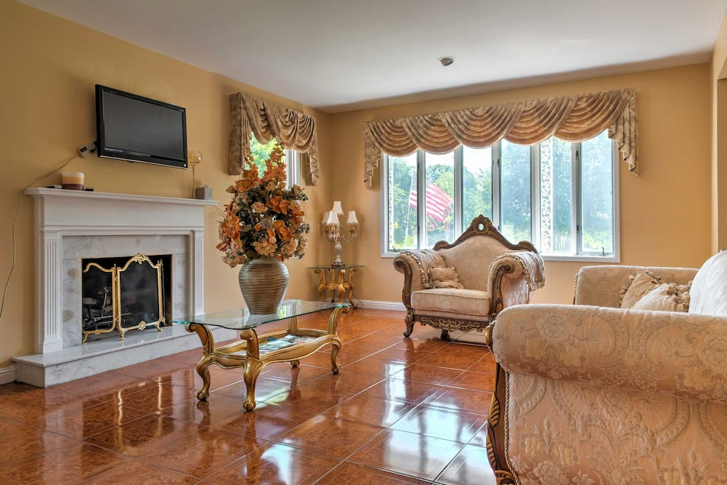 Relax amidst the home's comfortable furnishings, ceramic tiles, and elegant decor.