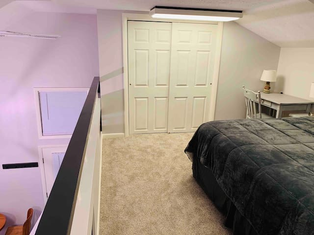 King bed up in loft with closet