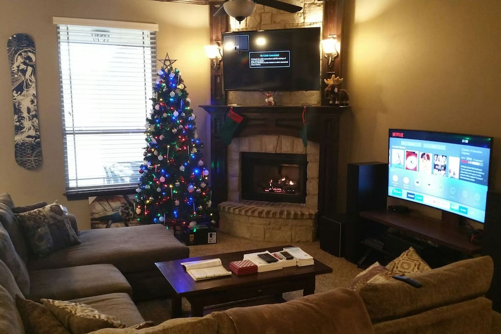 Living room with 2 TVs, 7.2.2 Atmos Surround Sound and Fireplace!