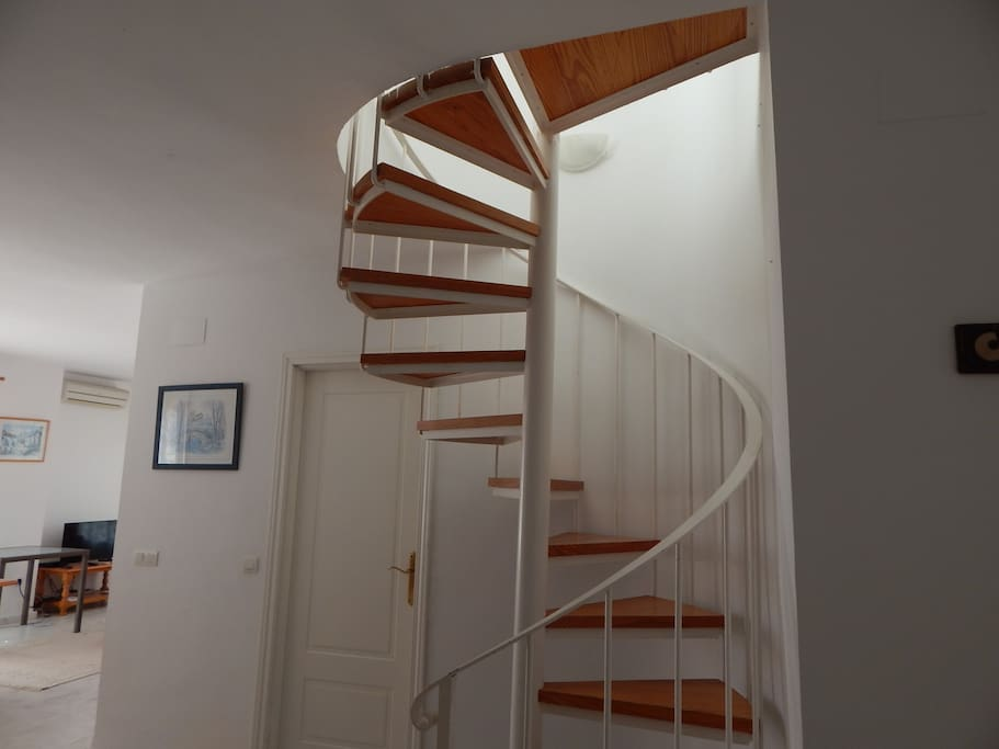 bright sunny stairwell to top floor master suite