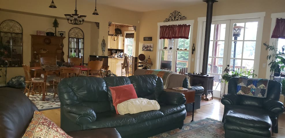 Large Livingroom, Dining room, Large french doors on both sides of room.  Center of the house