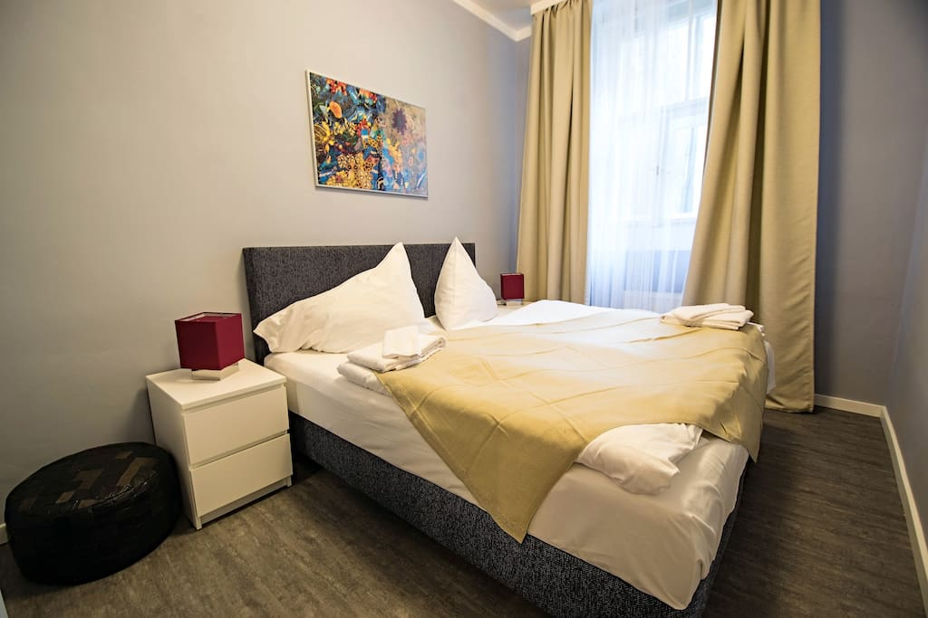 1st bedroom with comfortable double bed in bright color