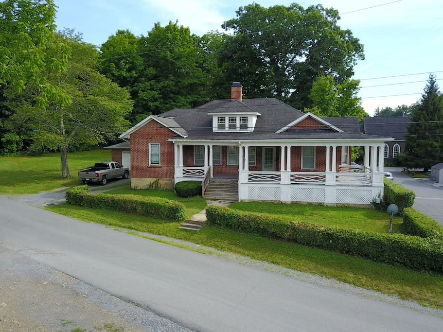 The Manse sits by itself, with large yard space.  No immediate neighbors.
