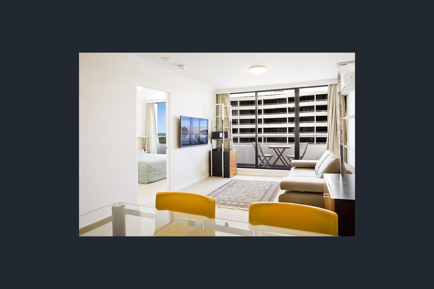Beautifully arranged air-conditioned living space (lots of natural sunlight), with over-size flat TV to screen Foxtel HD movies, leading to a balcony.  Blackout curtains for privacy and to keep away sunlight are installed.