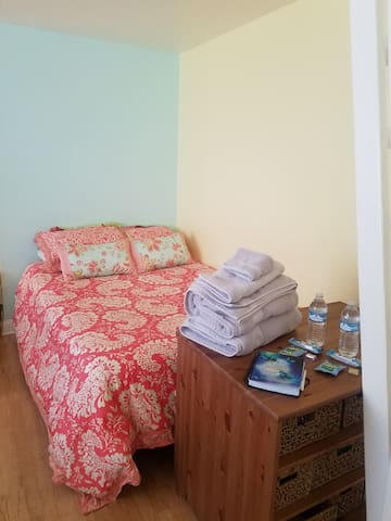 Large spacious bedroom, comfy double bed, crib.