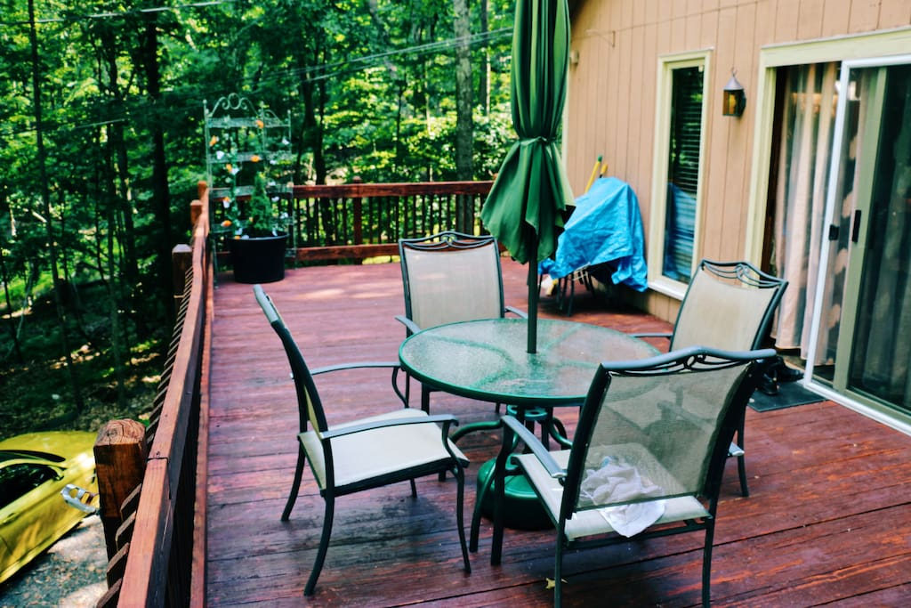 Large deck with patio table, additional foldable table available to seat 13