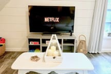 Smart TV - login to your own Netflix or music accounts. Or play with our selection of board games/puzzles!