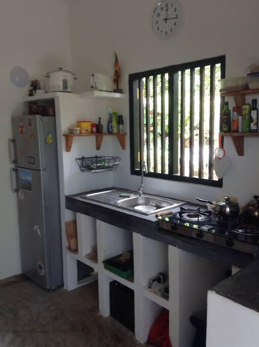 Kitchen with three burner hob.