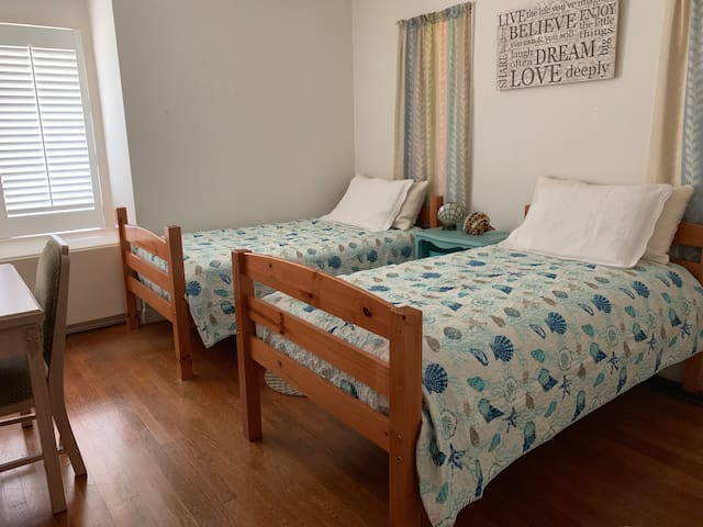 Bedroom has a closet, 2 twin-size beds w/ new beddings, writing desk/chair, & carbon monoxide detector.  Bedrooms are cleaned/sanitized, & beddings changed immediately after a guest/s' departure.  Cleaning service for month long guest/s is Thursdays