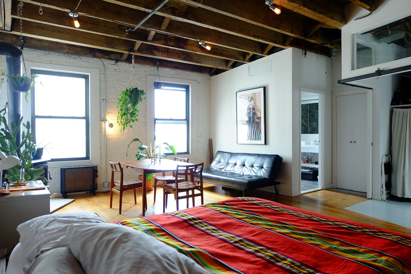Sun-lit loft. 12 foot ceilings in Manhattan.