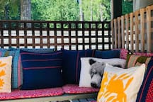 Cosy up with many cushions in the private gazebo area