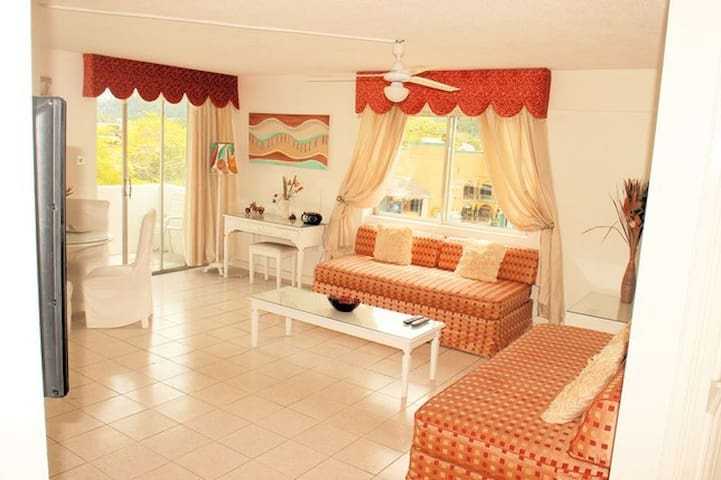 Spacious lounge , with balcony giving views of the sea, and the mountains...