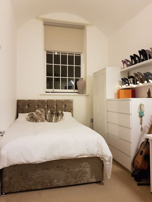 Wardrobe hanging space is available, and guests can borrow our iron and ironing board.