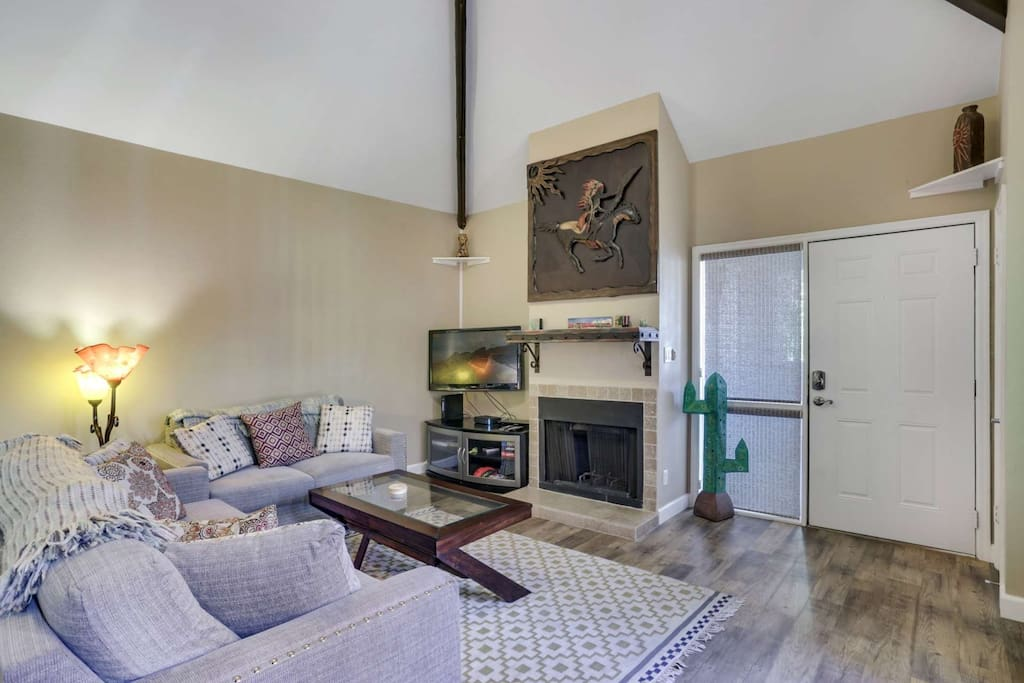 There's nothing better than after a long day coming back to this cozy living room with flat screen TV and wood burning fireplace