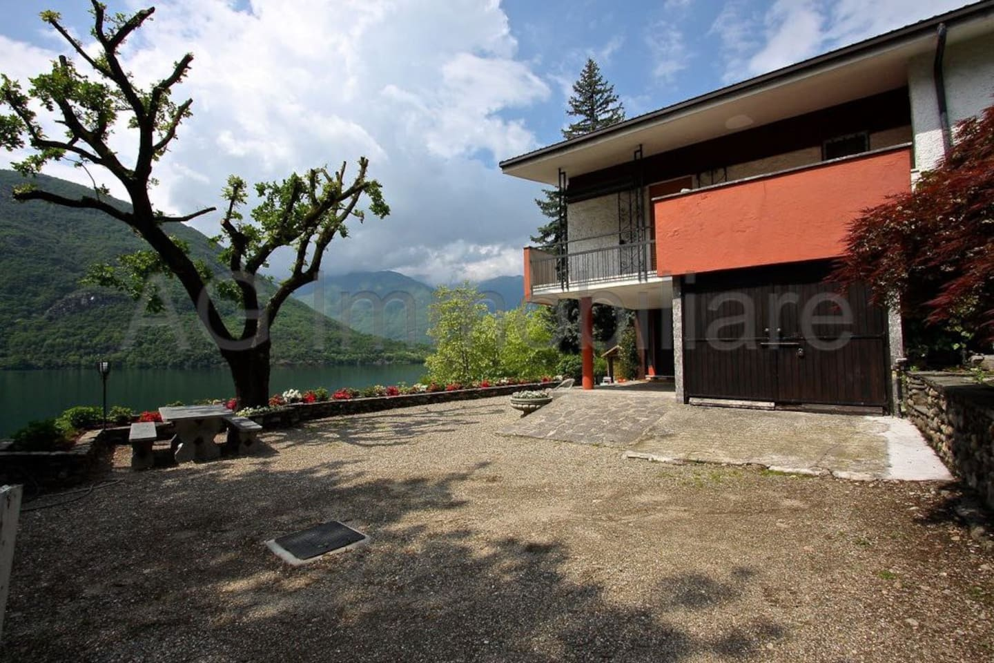 """Split-level detached lakefront home with 1000sq metres of garden. Tucked away on the hidden gem of """"Lago di Mergozzo"""", literally next to Italy's much more famous """"Lago Maggiore""""."""