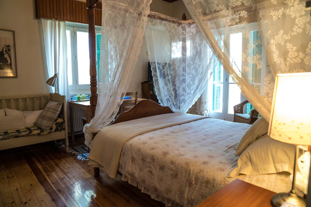 Bedroom with 4 poster bed and walk out balcony