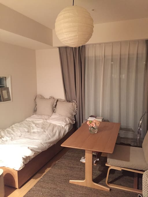 Single MUJI bed. MUJI table and MUJI sofa chair.. I love MUJI