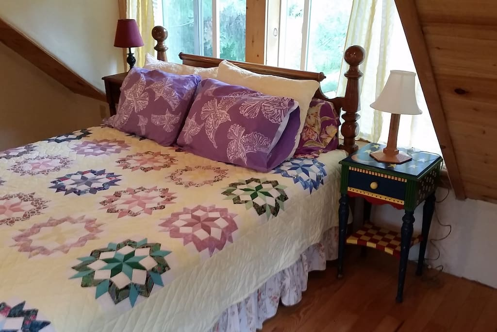 comfortable queen size bed  with whisper of pine boughs and nearby stream.