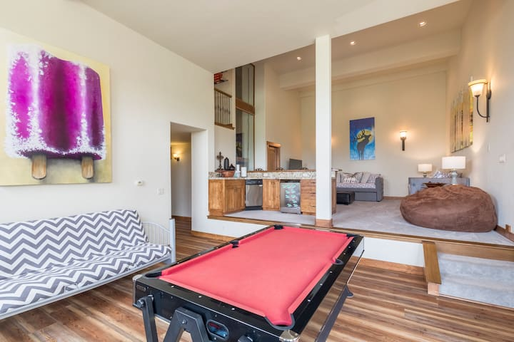 Lower Level Great Room! A great place to play with pool table, board games, a wet bar, and access to the private, new Hot Tub!