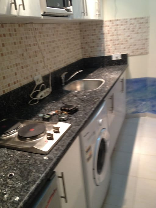 Kitchen with microwave range  undercounted fridge and clothes washer