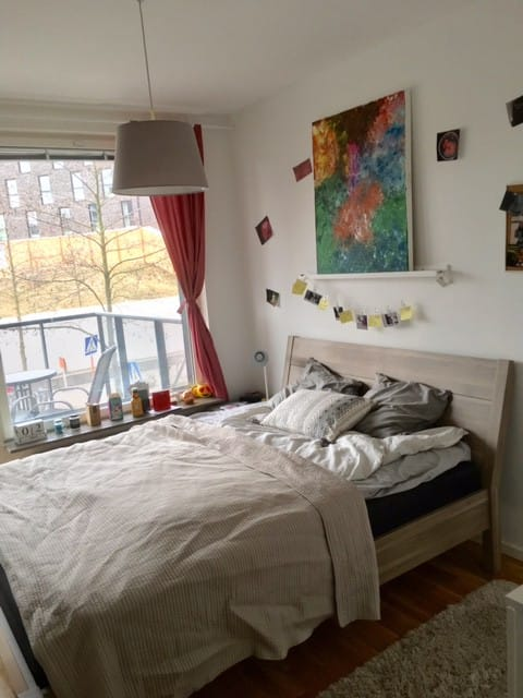 room with double bed, balcony and private bathroom