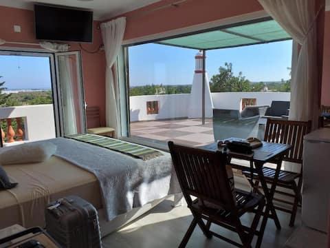 Alojamento  Patudos.  Suite with private terrace.
