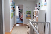 Hallway joining the kids rooms and the bathroom.  Reading nook for kids.