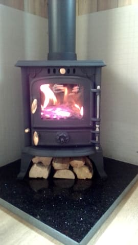 Log burner giving a warm feel after a long walk or bike ride