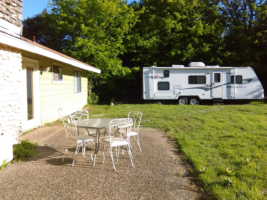 Travel Trailer Parked in Back Yard with Full Hookups