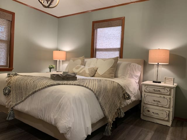 Bedroom #2 has a King bed, two night stands for storage, sound machine & a portable fan for your convenience.