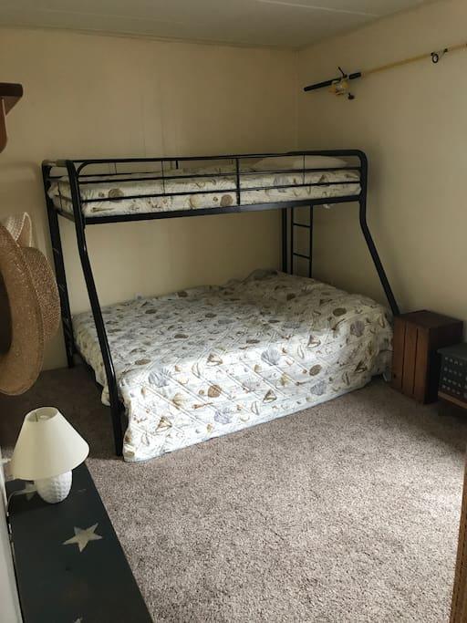 Bedroom 1. Top bunk a single, bottom bunk a double.
