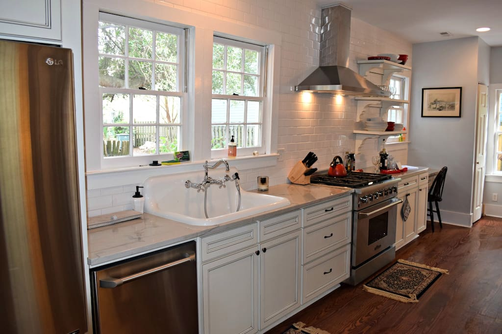Kitchen with farmhouse sink and six burner gas range
