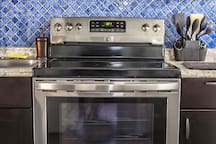 Brand new high end Professional Kenmore Stainless Steel Appliances with copper pans, coffee maker and high end dishes. Kitchen Cabinets are solid wood and high quality.