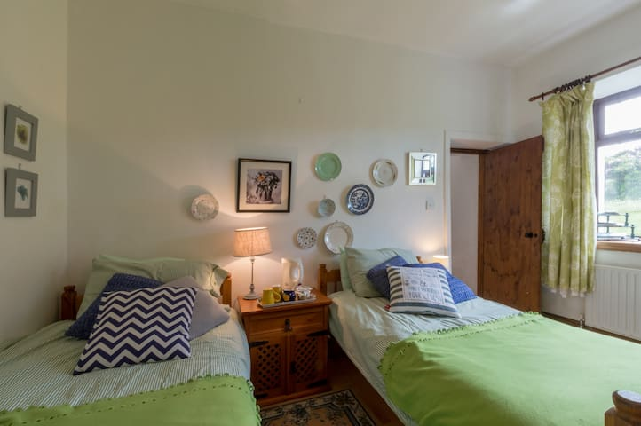 Double bedroom, with view towards the garden.