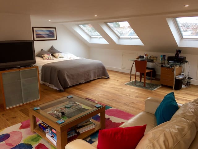 Loft bedroom with Kingsize bed (can be split in to two singles) and lounge area.