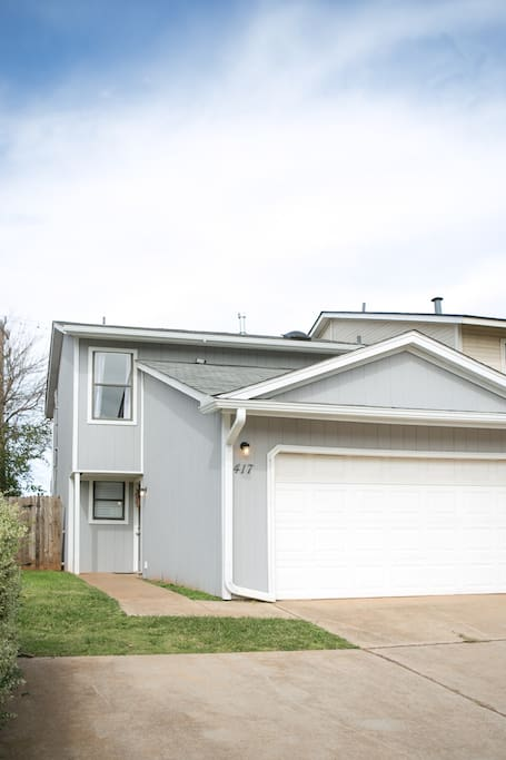 Two story home with attached garage.