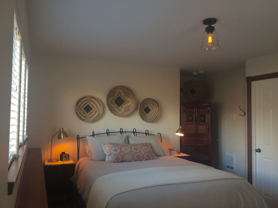 Your private room for two with a queen sized bed that has a memory foam mattress, down comforter and linen bedding.