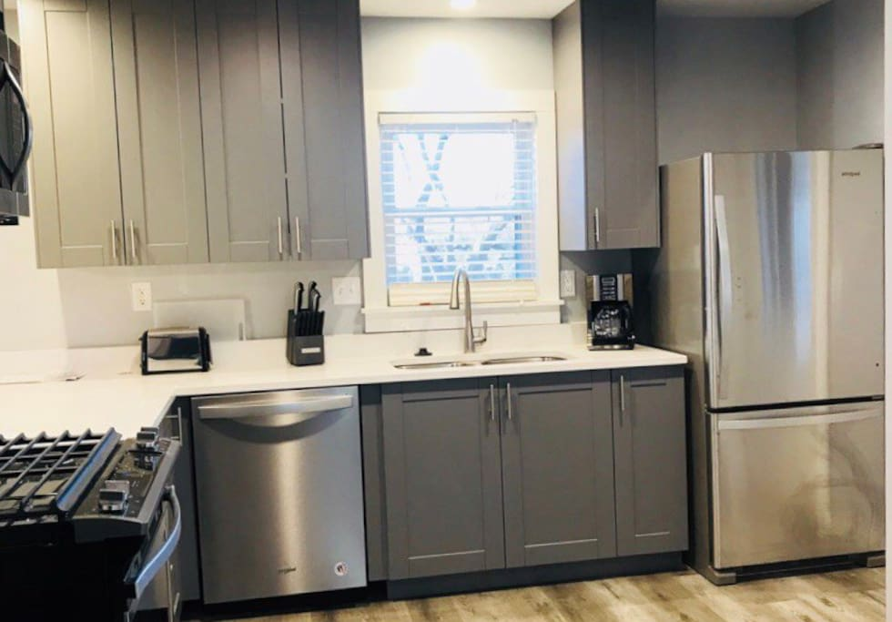 Completely remodeled kitchen with quartz countertops, stainless appliances and new cabinets!