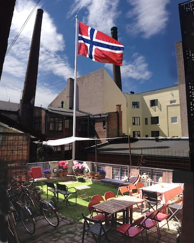 The courtyard/garden is available for guests. Here shown dressed up for 17 May celebrations.