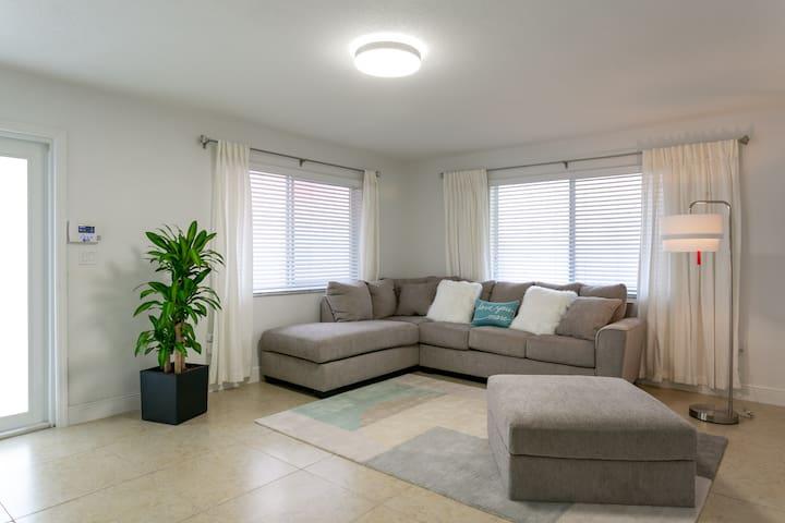 Spacious living room with a cozy and comfy sofa.