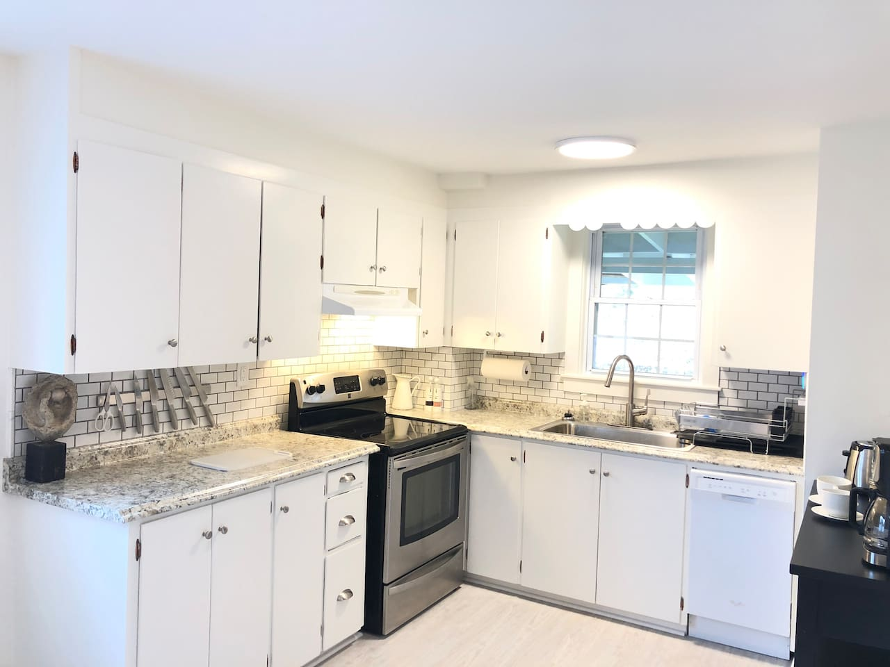 A cook's kitchen with necessary cooking supplies for a quick meal on the way out to enjoy a hike or to prepare a nice dinner. Includes dishwasher and electronic range.