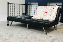 Futon for sleeping or just lounging.