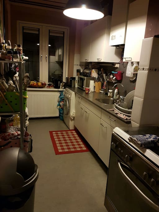 kitchen with large stove, nespresso and use of washer and dryer, pots, pans and utensils
