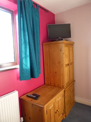 Wardrobe & cupboard space with TV with Freeview channels.