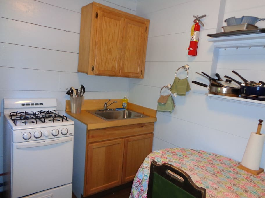 The kitchen has a gas range, full-size refrigerator, table for two and all of the cooking and dining utensils.