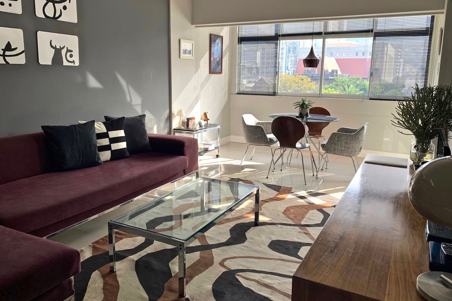 The open plan living room, with views over Cape Town Catherderal, Company's Garden and Signal Hill.
